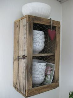 DIY| crate made into cabinet- plus chicken wire. Cute in a bathroom
