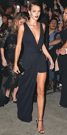 Met Gala 2015 Afterparty Dresses : ROSIE HUNTINGTON-WHITELEY Her Gala Gown: A rose-gold Atelier Versace gown with strategic swirls. Her Afterparty Outfit: A Versus Versace black dress with plunging neckline, high slit and Jimmy Choo heels.