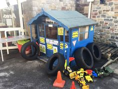 Fabulous garage or mechanics roleplay area using Twinkl's display materials.