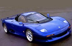Jaguar XJR-15 Review by: Phillip Maher The Jaguar XJR-15 was powered by a 450+ bhp version of JaguarSport's 6.0 litre V12 mid-mounted engine. Built in a strictly limited number, 50, and costing around $800,000.00, the XJR-15 stemmed from Project R9R - a concept car developed by JaguarSport. The XJR-15 was designed by Peter Stevens, who went on to help develop the Mclaren F1. Its performance and limited build quantity make the XJR-15 one of the true Supercar of our time.
