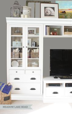 Give your space an easy update by adding grasscloth wallpaper to the backs of your bookcases.