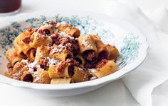 "Rigatoni with Spicy Calabrese-Style Pork Ragù | Any short, tubular pasta will work with this meaty ragù. We used sedanini (""little celery"") on the cover, but easier-to-find rigatoni and penne are great, too."