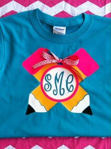 This is a great back to school shirt. It is two pencils intersecting with a circle monogram, accented with a ribbon. Ribbon will vary upon availability. You can customize the colors of design by sending an email.