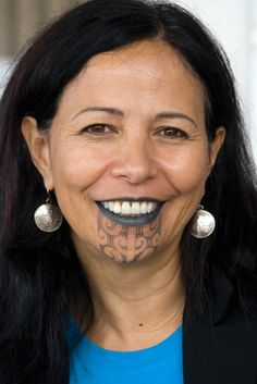 Judge Caren Fox (Ngāti Porou, Rongowhakaata), deputy chief judge of the Waitangi Tribunal and a specialist in international human rights, wears the moko kauae (chin tattoo) and ngutu pūrua (fully tattooed lips).