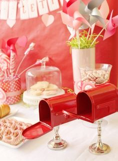 Love this idea for a Valentine's Day party... mailboxes on candlesticks as centerpieces. See more party ideas at CatchMyParty.com. #valentinesday #partydecorations