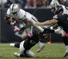 Oakland Raiders wide receiver Denarius Moore #17 is tripped up by Houston Texans tight end James Casey #86 for an 11-yard punt return during the third quarter of an NFL football game at Reliant Stadium on Sunday, Oct. 9, 2011, in Houston. The Raiders beat the Texans 25-20.