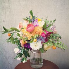 kumquat, maiden fern, dahlia, ranunculus bouquet by lovely little details