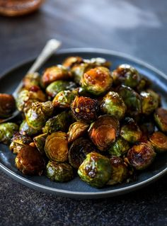 sweet and spicy brussels sprouts are roasted to perfect and the most delicious side dish! It's a great way to elevate regular old brussels sprouts and make a fantastic side to to serve on a weeknight! Spicy Brussels Sprouts Recipe, Roasted Sprouts, Honey Balsamic Brussel Sprouts, Asian Brussel Sprouts, Sprout Recipes, Spicy Recipes, Healthy Recipes, Vegetable Side Dishes, Vegetable Recipes