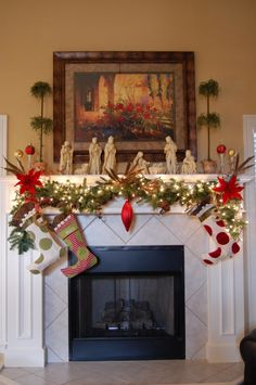 Adorable Christmas Mantel Decorating Ideas For The Upcoming Christmas Holiday : Gorgeous Fireplace Decorating Ideas With Cute Miniature Santa Claus Socks Also Nativity Theme Small Sculptures