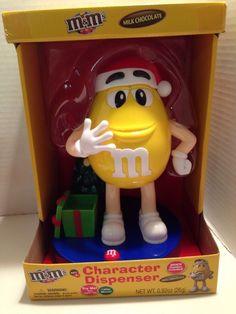 89e4d343818 M M s 2016 Christmas Dispenser Mr Yellow Light   Sound Present   Tree Santa  Hat