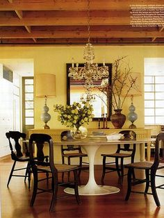 Modern traditional mix: White Saarinen table + dark wood chairs + blue lamps by xJavierx, via Flickr