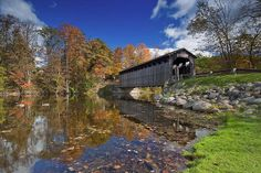 Fallasburg-covered Bridge stretches 100' & stands 14' wide & 12' high. It is one of only 3 covered bridges open to vehicle traffic in Michigan