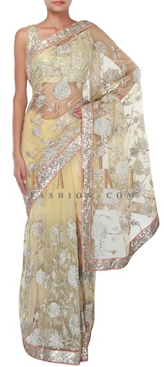Buy Online from the link below. We ship worldwide (Free Shipping over US$100) http://www.kalkifashion.com/lime-yellow-saree-adorn-in-zari-and-sequin-embroidery-only-on-kalki.html