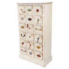 Weathered wood apothecary chest with numbered drawers and multicolored pulls.  Product: CabinetConstruction Material...