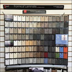 Formica Specialty Laminate is offered for consideration by this Curved Peg Hook Sample Board. Look close to see that it hangs against a flat surface, Formica Laminate, Sample Box, Display Ideas, Kitchen Island, Boards, Wall, Island Kitchen, Planks