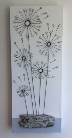 Hand formed wire dandelions on canvas