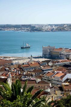 From the top of an hill - a boat slides in the Tagus Tiver - Lisbon, Portugal
