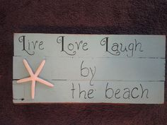 Beach sign out of old house wood.