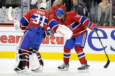 "What a pair! Carey Price #31 and P.K. Subban #76 of the Montreal Canadiens do their ""triple low-five"" celebration"