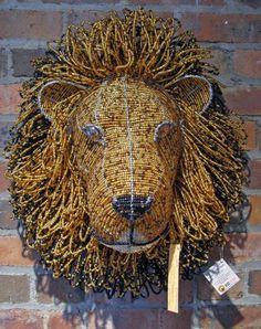 Artist:  Enock Mpofu  Beaded Lion Head