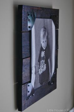 Photo Idea - simple DIY! Some wood and the little leather corners let you change out the photos