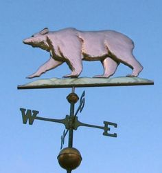 California Golden Grizzly Bear Weather Vane by West Coast Weather Vanes.  While the California Golden Grizzly Bear weathervane is similar to our more traditional Grizzly Bear weathervane, this design is modeled after the California state flag. We have made it a bit more massive and powerful looking to reflect its stature as the largest of the North American bears.