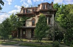 Pinch Me. This Stunning Old House is Just $30,000! No longer listed on Craigslist, but MAN I wish I could buy it! I can't believe all the gorgeous woodwork on the Mansard Roofed Beauty!