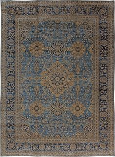 A Persian Kirman (Kerman) rug, the sea blue field with playful flowering vinery around a cusped camel medallion within a midnight blue palmette and flowering vinery border. Watch full size video of A Persian Kirman rug, Circa 1920, ID BB0769 - Video