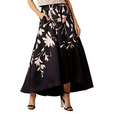 The Saffy Printed Midi Skirt is a sensational skirt with statement volume, perfect for any special occasion. Featuring a soft floral print which gives a modern appeal, and pleats at the waist which create exaggerated fullness and dramatic flaring. Fully lined for the most fluid fit this high low skirt is finished with side pockets. Skirt measures 118.5cm from top edge of waistband to back hem.