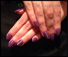 Akzentz gel nails with almond shape and rhinstone accent