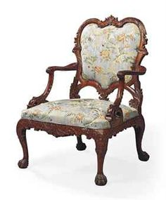 A GEORGE II MAHOGANY ARMCHAIR  AFTER A DESIGN BY THOMAS CHIPPENDALE, CIRCA 1755