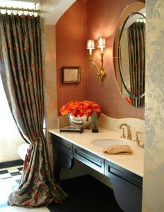 nice idea with the drapery panel to separate the vanity/commode area