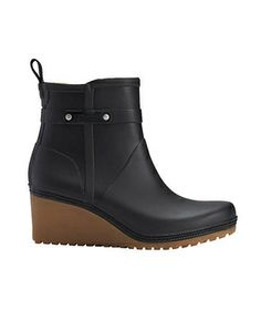 """CUTE RAIN BOOTS:  """"Tretorn Plask Mid""""  These rubber wedges are the height of fashion. Plus, the added boost practically ensures you'll stay nice & dry amid the puddles.  To buy: $85, us.tretorn.com."""
