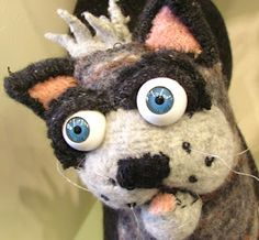 Larger than life-sized house cat, from reclaimed woolen garments and wire. Personality plus!