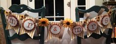 Banner I made for my sister's wedding; supplies used - Build a Banner kit, burlap ribbon, Cajun craze card stock (for rosettes). Designed and made by Jeanie Tavitas-Williams