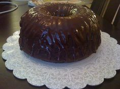 Chocolate Glaze for Cakes (That Hardens) from Food.com: This must be put onto a cold cake that has chilled from the refrigerator or it will not harden, this works wonderful for a bundt or tube cake, it may also be used for an ice cream cake --- this glaze firms up but does not turn rock hard
