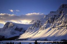 Find where to stay and what to do in Canmore, AB. Discover all that Canmore has to offer and get all of the local knowledge for your perfect vacation. Park Landscape, Winter Landscape, Parc National De Banff, Location Chalet, Stations De Ski, Destinations, Mountainous Terrain, O Canada, Rocky Mountains