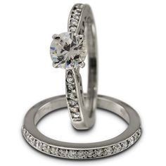 Antique Two Ring Engagement Setting In 14K White Gold - Set in 14K white gold, the rings have a faux-channel setting for brilliant white diamonds. This style wedding band is popular and in demand. In the engagement ring there is interesting openwork on the gallery.