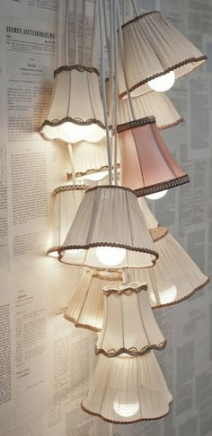 """Vintage lamp shades, but I'm also intrigued by the """"wall paper."""" I might be able to do that with the left overs from my book purses for art crawl! Lamp shades and wall paper, but the wall paper I saw of invention sketches. Luminaria Diy, Recycled Lamp, Retro Lampe, Deco Luminaire, Home And Deco, Lamp Shades, My New Room, Lamp Light, Light Bulb"""