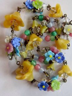I have a necklace made like this. Mine has pink and blue flowers...