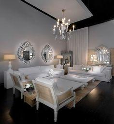 LIVING ROOM:  Elegant white formal living room / sitting room with dark floor and multitude of mirrors.