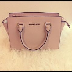 Michael Kors handbag Michael Kors Selma handbag medium in the color Ballet. Brand new with tags, shoulder strap, and dust bag. Don't ask my lowest -- submit an offer. No low ballers, please. NO TRADES. Michael Kors Bags