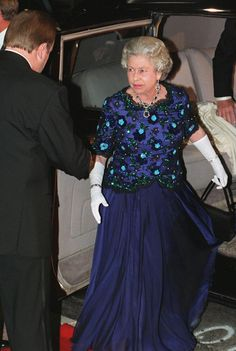 The Queen looks kind of great, doesn't she?  Now that is a very lovely dress.   She can actually rock it once in a while.