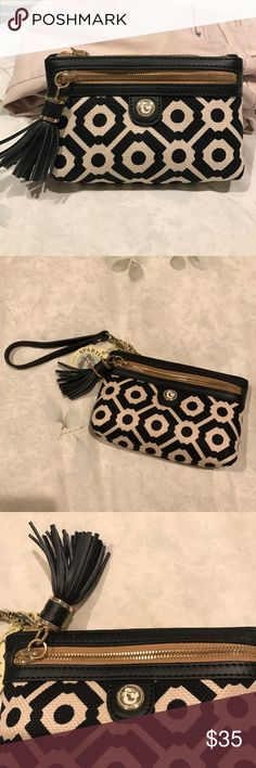 Patterned canvas clutch/wristlet Stunning navy blue and cream patterned canvas clutch/wristlet with navy blue leather trim, tassel, and wrist strap, and gold zipper details. Purchased from a beautiful boutique in South Carolina. Brand new with tags, in perfect condition. Wristlet strap is removable so it can become a clutch instead. Spartina 449 Bags Clutches & Wristlets