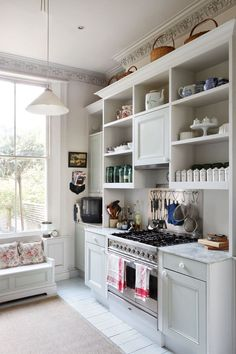 """How's this for an Ikea 'hack'? Using cabinets and shelving from [link url=""""http://www.ikea.com/gb/en/""""]Ikea[/link], design writer Lucia Van der Post's builder created two huge kitchen dressers 'the sort that you might have found in an old pantry'. He added grey marble worktops, some early Victorian-style moulding to the cabinet doors, and plain, white china knobs. The main cupboard doors are painted in 'Beauvais Grey' from [link url=""""http://www.papers-paints.co.uk/""""]Papers & Paints[/link]…"""