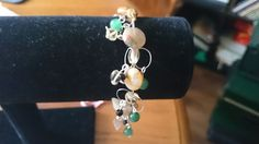 Charm bracelet using, botswana agate, black agate, green coloured quartz, citrine and labradorite chips www.facebook.com/KimsGlitteringGems
