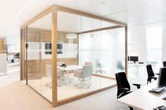 An elegant simple cube with wood and glass at the offices for power company Nuon. Design by HEYLIGERS Design+Projects.
