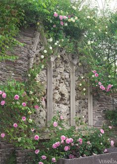 "Her husband was right, and from this thicket the couple has fashioned a midsummer night's dream of a garden. ""We wanted to create an aura of a timeless, lost domain,"" says Isabel. The seven-bedroom house is now restored to splendor, clothed in dangling wisteria and the pale yellow, early-flowering Rosa banksiae. Blooms in complementary tones wreath a garden wall. Rosa 'Blairii Number Two' and 'Albéric Barbier.'   - Veranda.com"