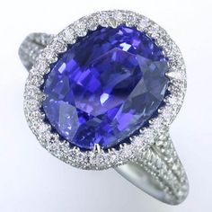 Precious Color Rings   A remarkable 6.63 ct. natural blue Sapphire is elevated by a dazzling row of .95 ct. tw. Round Diamonds in this exquisite Platinum Sapphire and Diamond ring. SKU# : AD-2426