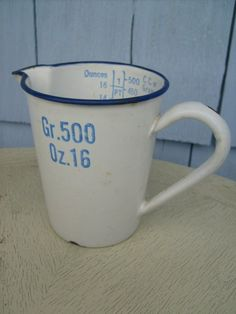 vintage measuring cup. HAVE THIS AND PUT ALL MY KITCHEN SHEARS AND KITCHEN SCISSORS IN IT ON MY COUNTER!